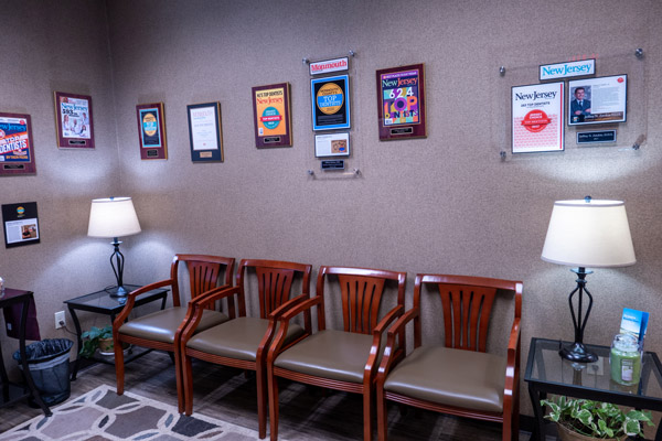 Awards on the wall at Premier Periodontics and Implant Dentistry.